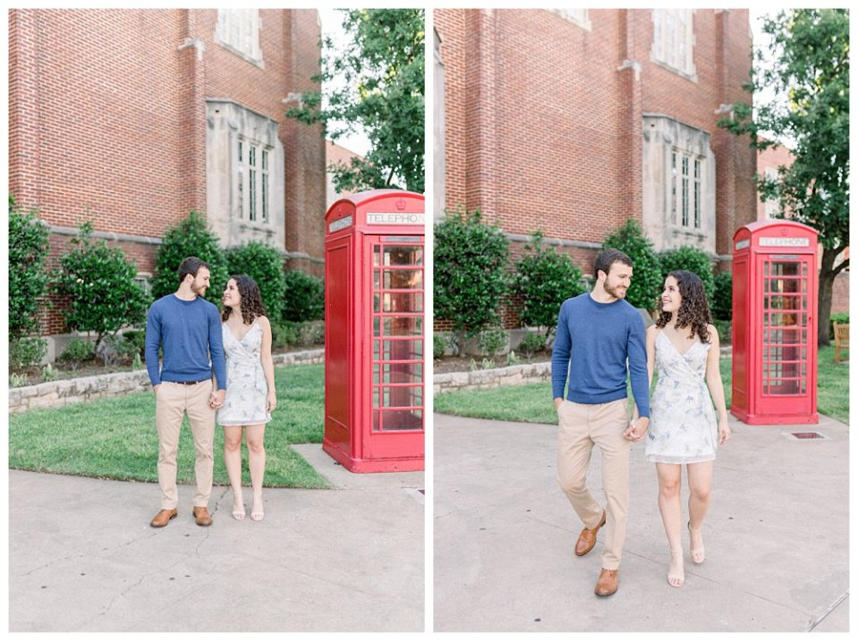 Couple standing next to telephone booth