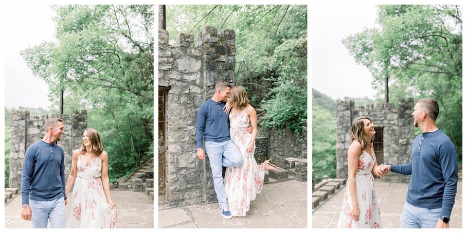Couple holding hands and laughing at old castle ruin engagement session
