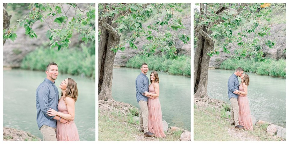 Couple embracing next to tree and river