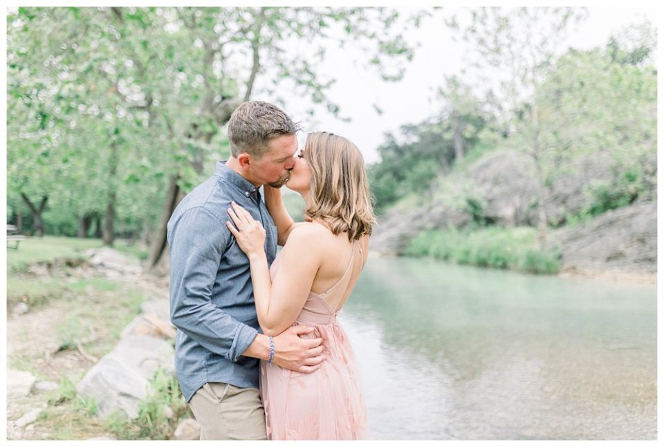 Couple kissing by river