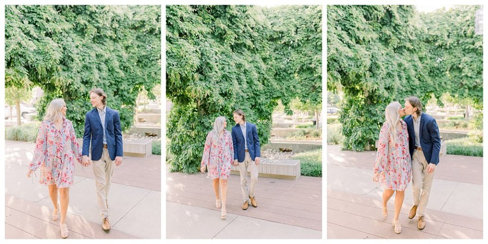 Couple holding hands walking through garden  in Guthrie Green / Centennial Park Tulsa engagement