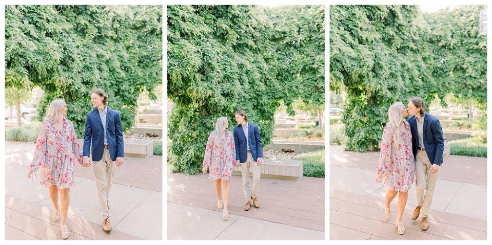 Couple holding hands walking through garden  in Guthrie Green / Centennial Park Tulsa engagement