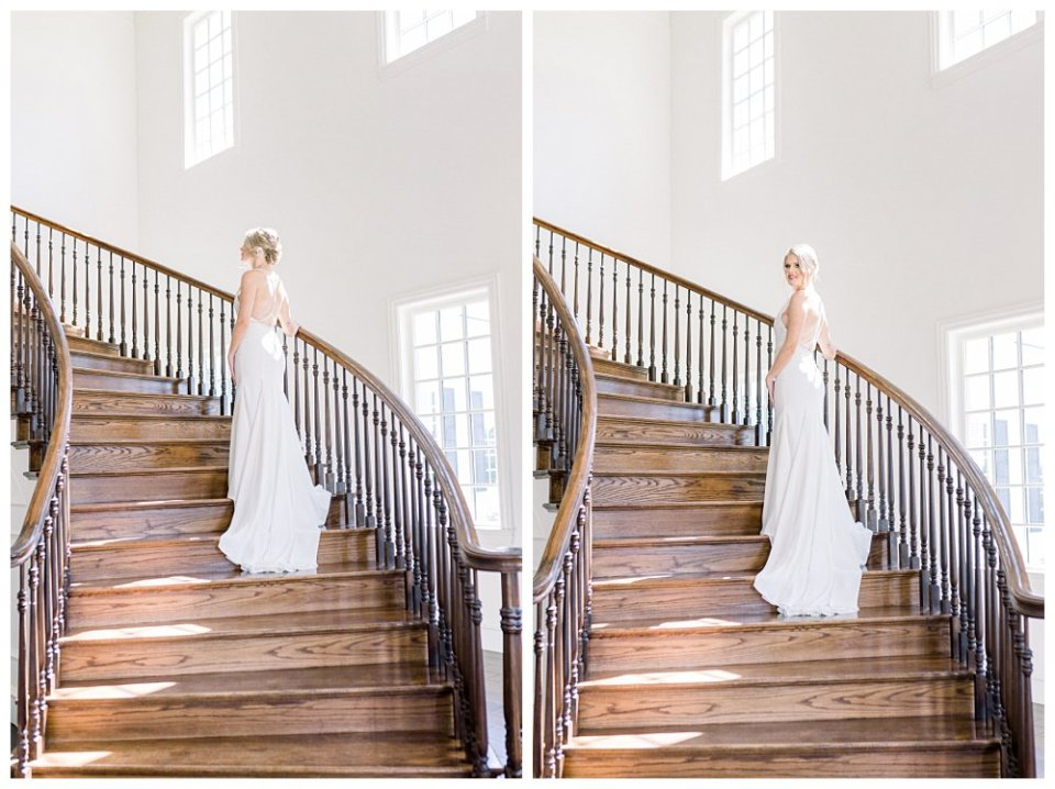Bride standing on wrap around staircase at The Milestone Mansion in Aubrey Texas