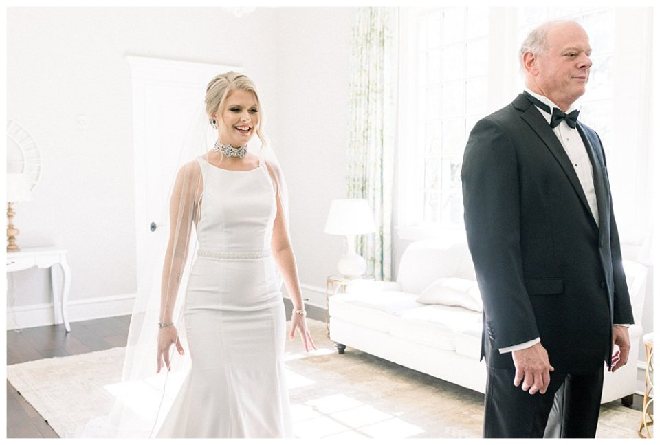 Bride walking up behind father for wedding dress first look