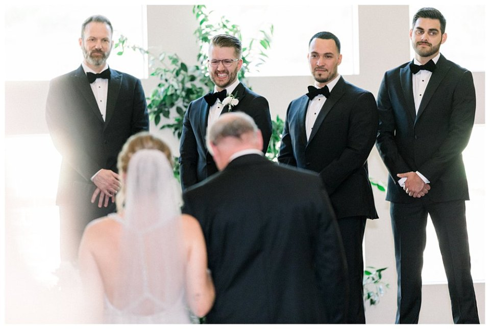 Groom sees bride walking down aisle- groom reaction