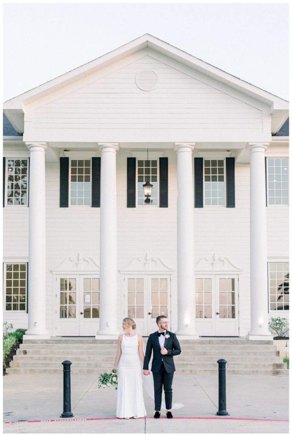 Bride and groom standing looking off in front of The Milestone Mansion wedding Aubrey Texas