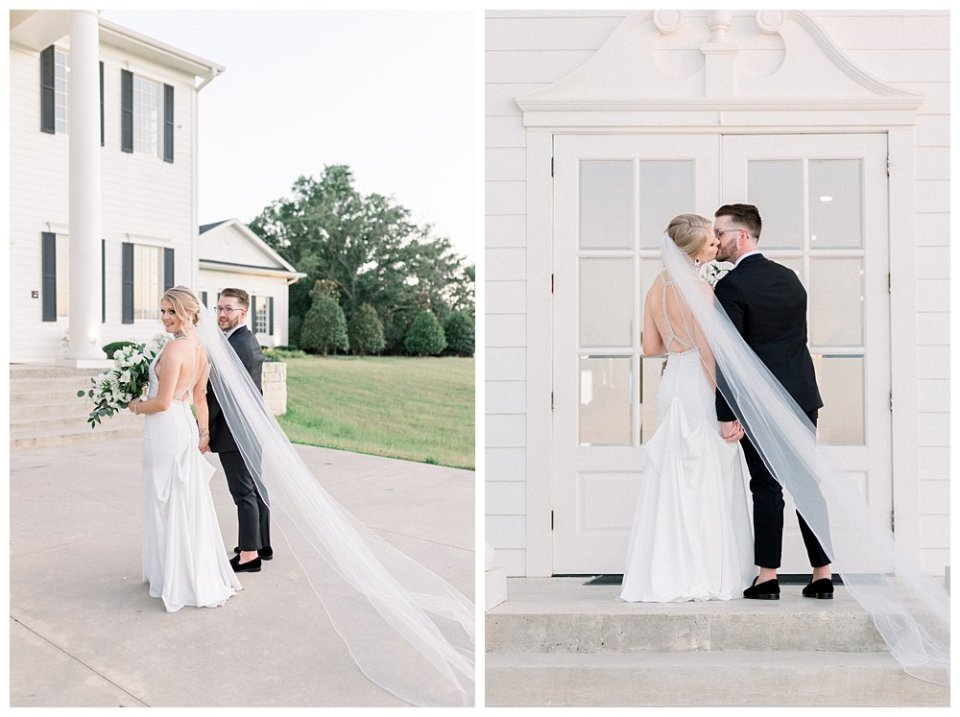 Bride and groom hold hands kissing in front of The Milestone Mansion in Aubrey Texas