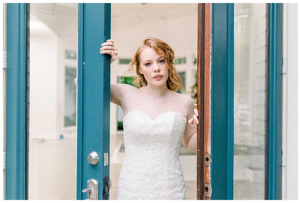 Bride standing between teal doors at Willow Creek Mansion bridal session