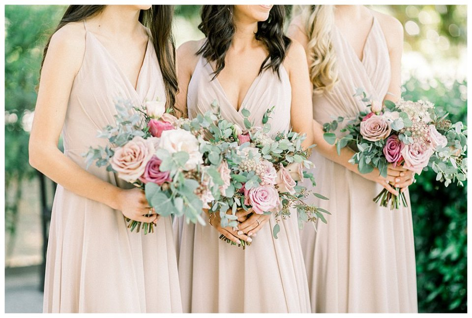 pink and blush bridesmaids bouquets cream bridesmaids dresses