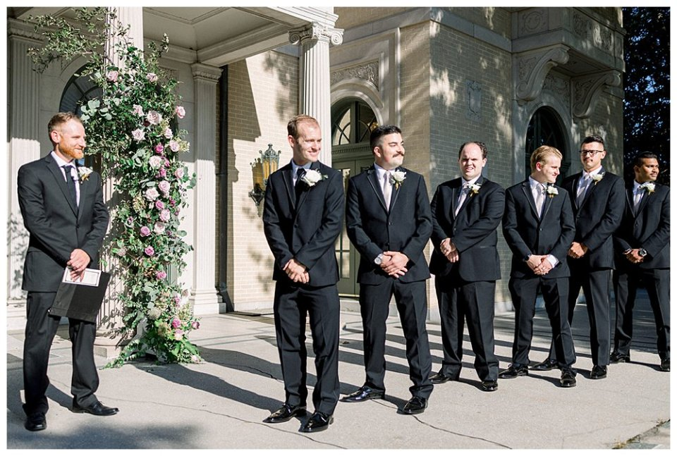 Groom standing at alter at Mansion at Woodward Park