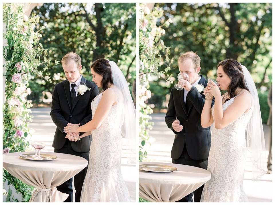 Bride and groom holding hands while preparing to take communion