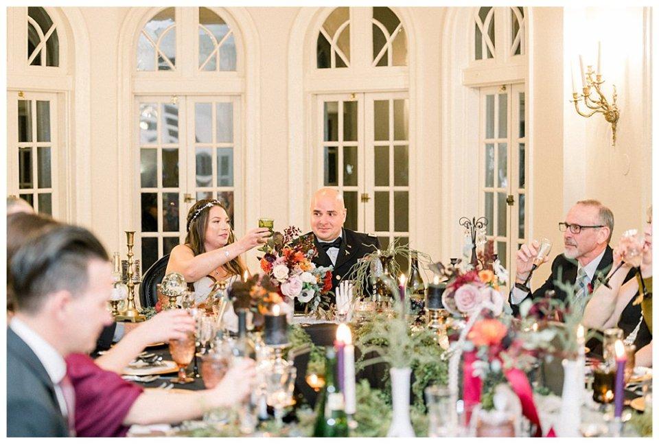 Bride and groom at reception dinner at Tulsa Garden Center- Mansion at Woodward Park