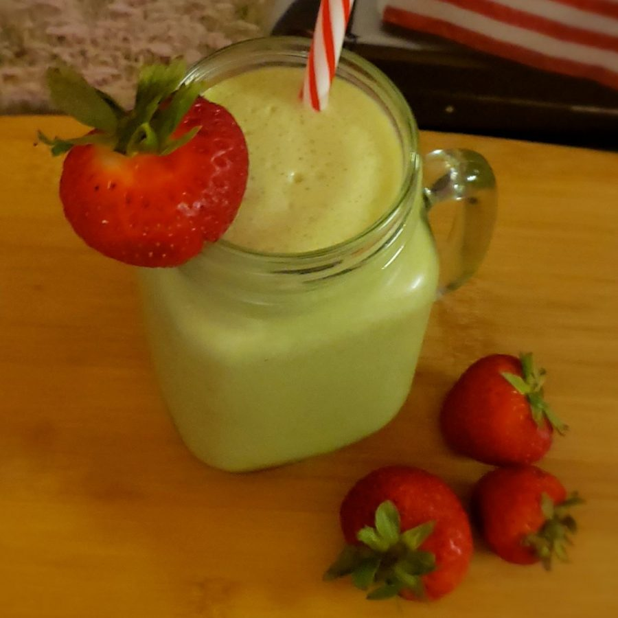 AILI Keto Strawberry Smoothie in a clear mason jar glass with red & white striped straw and strawberry garnish, made with FirstRate.