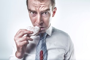 Post featured image of employee eating donut
