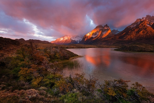 sunrise-light-paints-the-cuernos-del-paine-massif-in-amazing-red-light-patagonia-chile-photo-b-malan-44556