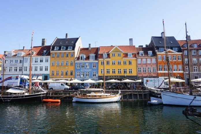 Nyhavn is a popular waterfront area in Copenhagen, Denmark, lined with lots of restaurants and colourful buildings. and is a must-visit as part of a two-day Copenhagen itinerary.