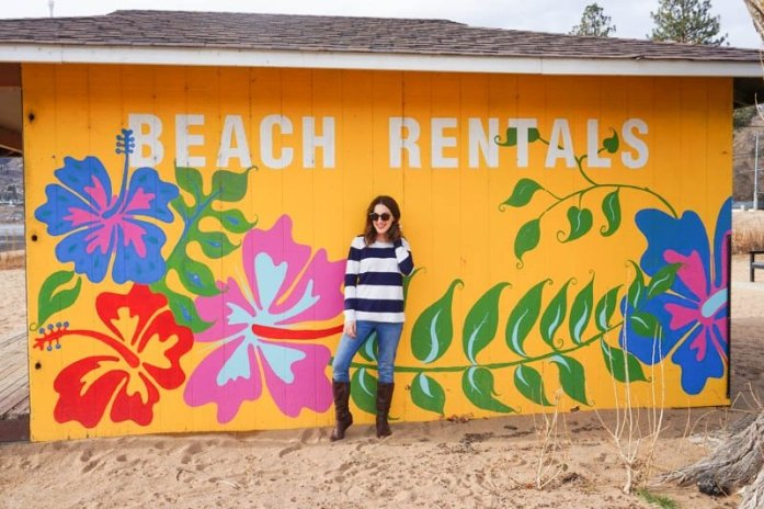 Yellow mural with tropical flowers on the beach rentals building in Penticton, British Columbia: Penticton's Most Instagram-Worthy Murals