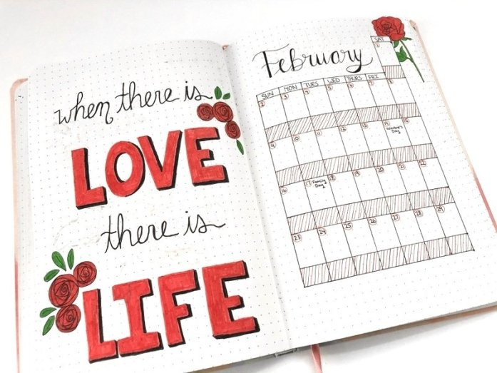 Bullet journal monthly calendar with red roses