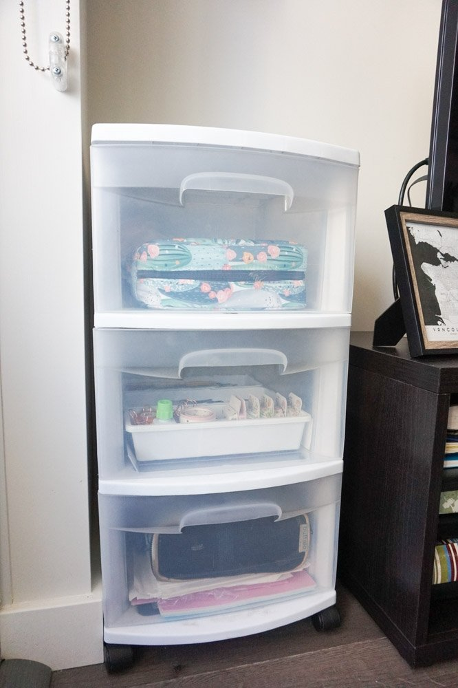 plastic drawers full of office supplies