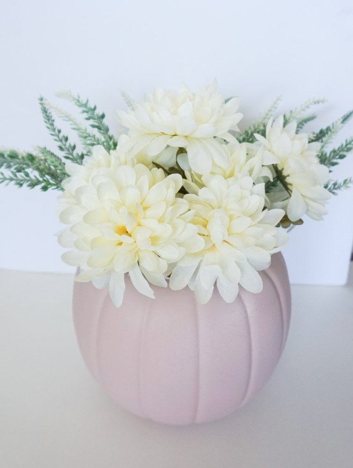 xblush pink painted plastic pumpkin with white flowers