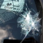 A garbage truck threw a relatively large rock at our windshield while we drove past each other.