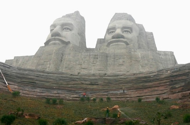 Labourers work at a construction site of the statues of Huang Di and Yan Di in Zhengzhou