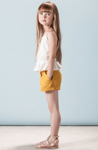 white tank peplum, mustard shorts