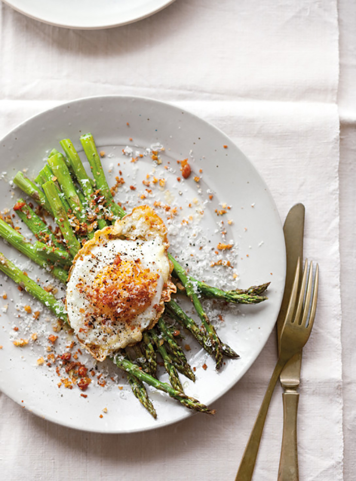 Fried egg and pancetta over asparagus