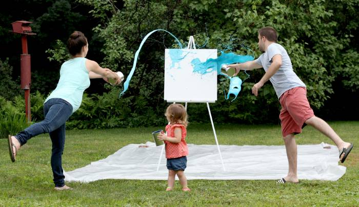 An artistic way to reveal gender with paint and a canvas!