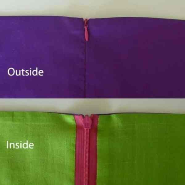 image of inside and outside of lined garment highlighting zipper sewn with invisible zipper foot. Outside zipper doesn't show, inside zipper is pink with green fabric