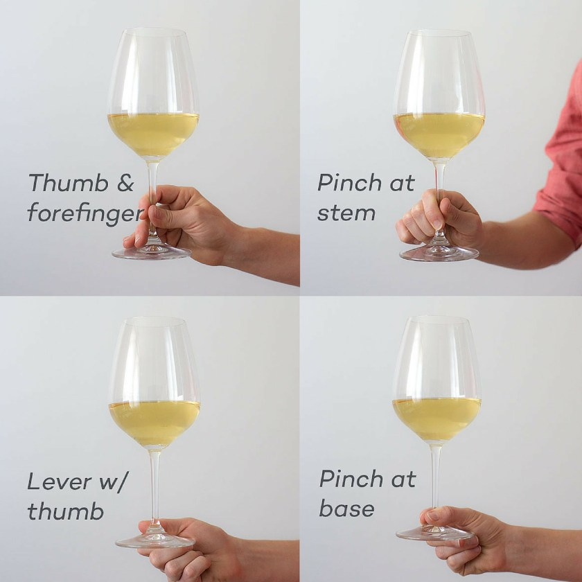 Ways to hold a wine glass that pass the social etiquette test hold a wine glass like a pro ccuart Gallery