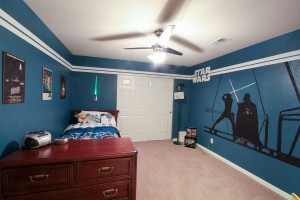 Our son is a huge Star Wars fan (or maybe it's me), so we decided to create the most awesome Star Wars room ever! We still aren't done, but this is round one. Everything was DIY and custom painted on the walls.