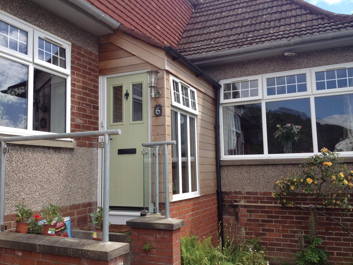cedar clad entrance porch extension