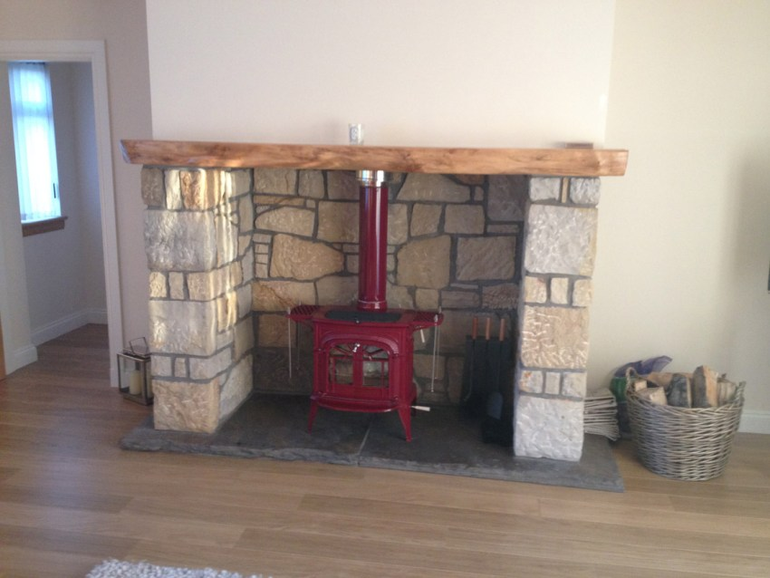 construction of tradtional fireplace with log burning stove