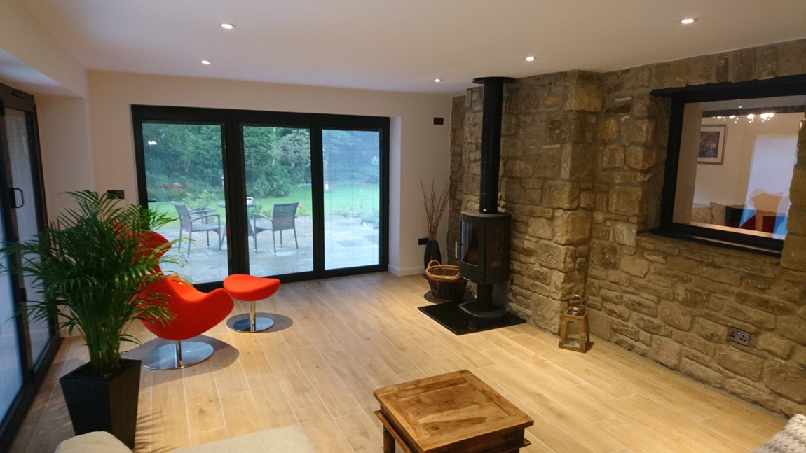 feature stone wall and stove within glazed extension