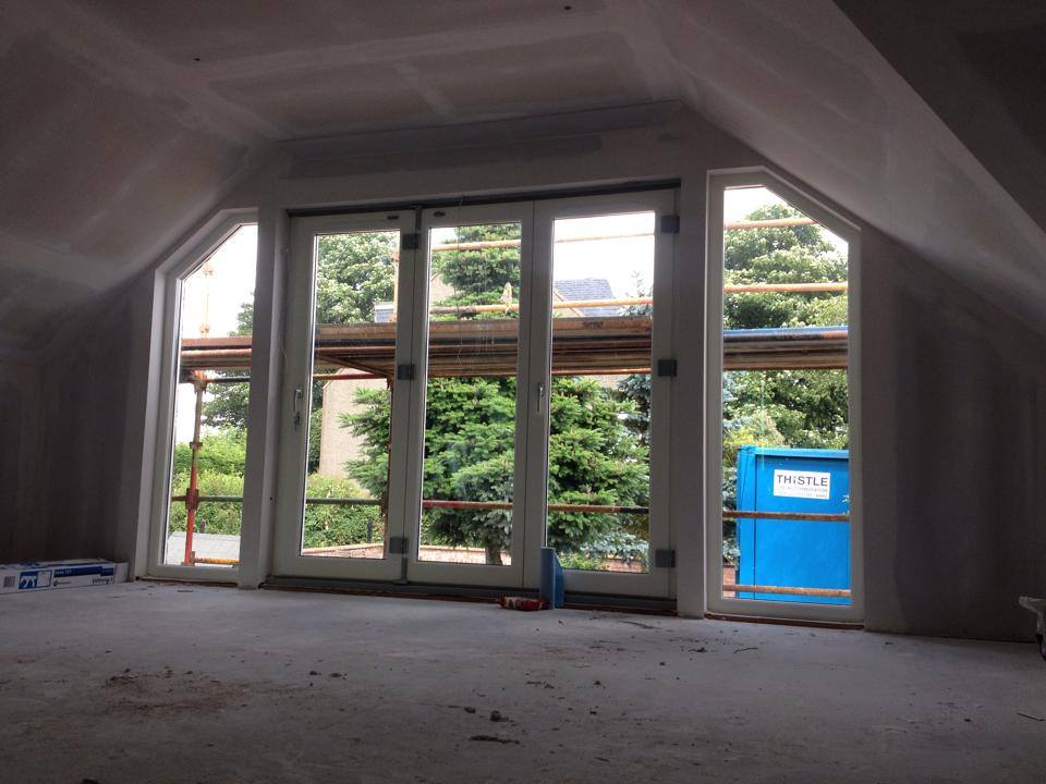 formation of bi-fold doors with angled fixed glazed panels