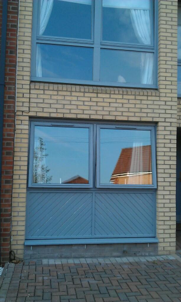 herringbone timber clad garage door build up to replicate former garage door