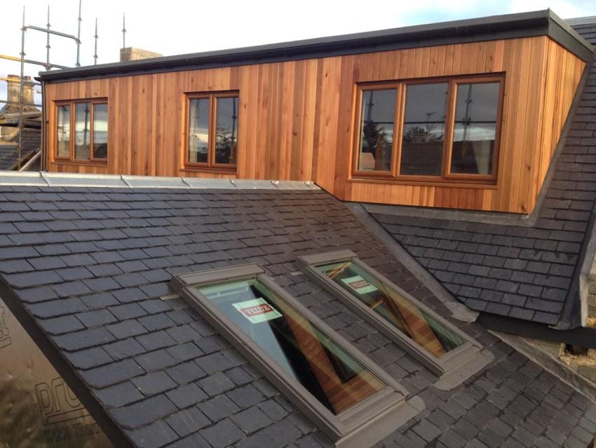 natural cedar clad dormer with light oak windows