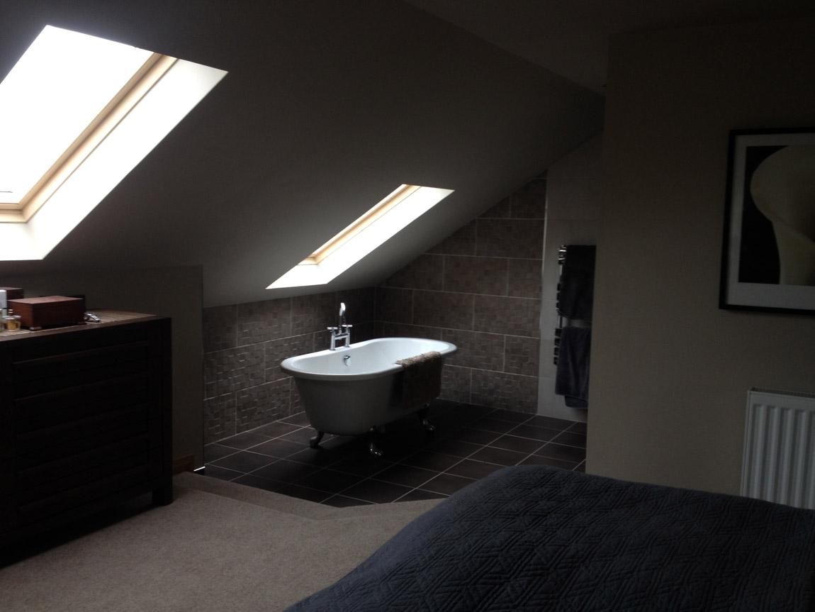 open plan master bedroom with bathroom facilities