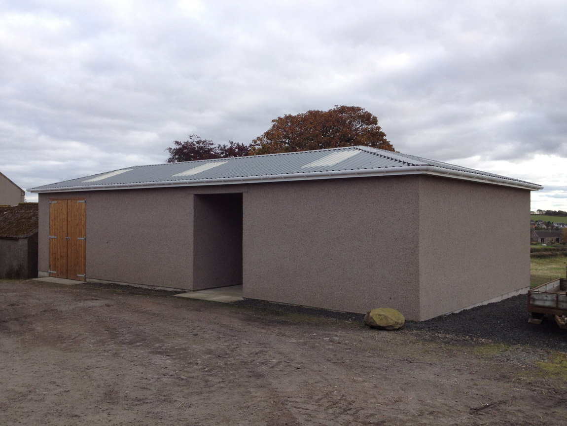 rendered horse stable with insulated roof system