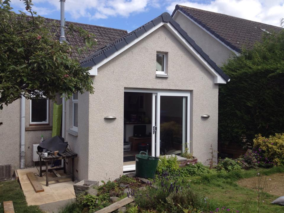 single storey extension with feature high level stain glass window