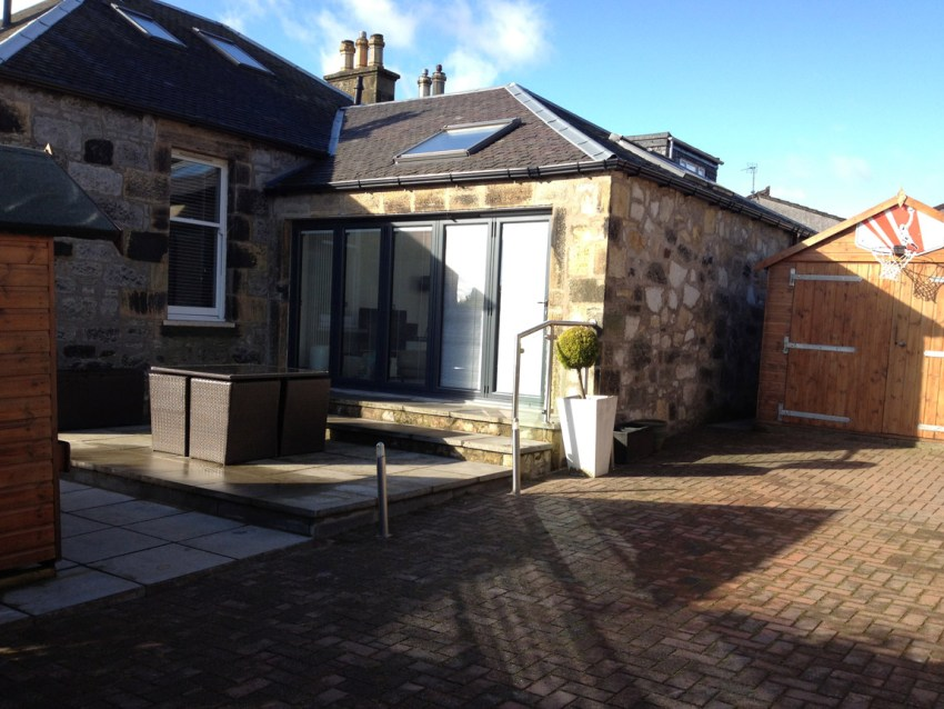 stone built extension with bi fold doors