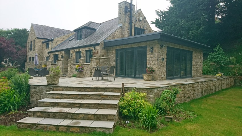 stone built flat roof extension