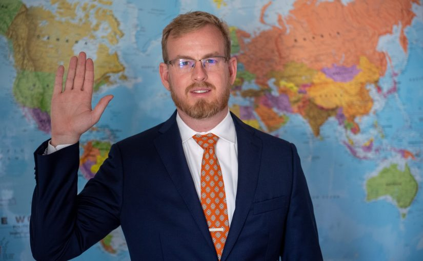 Andrew Shinn swears his oath of office to become a US Foreign Service Officer