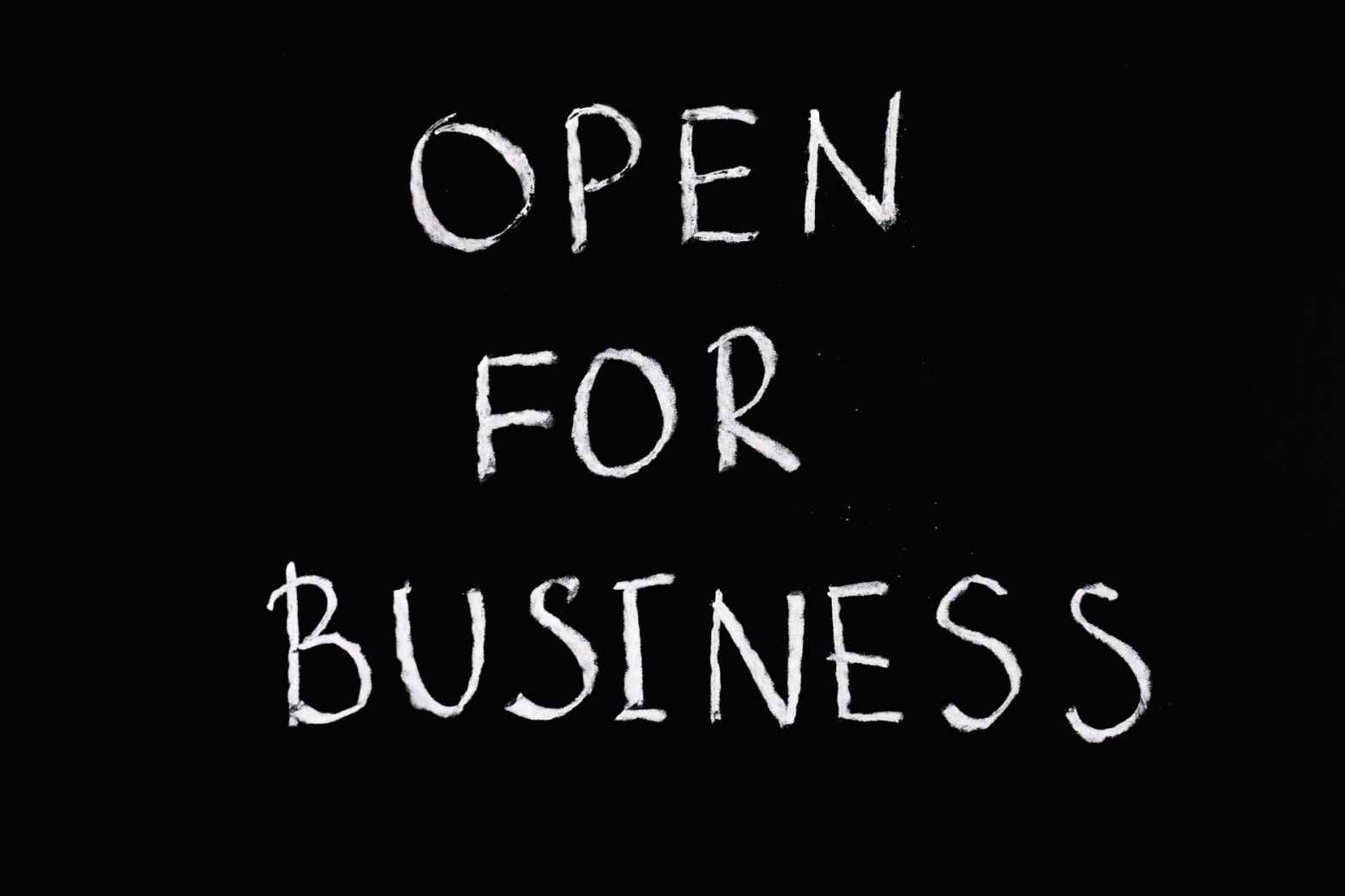 open for business lettering text on black background
