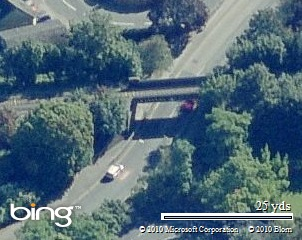 Police teams were set up around this bridge and grass on the right