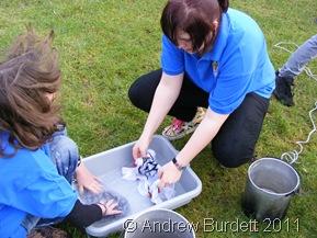 WET WIPE_Jamboreers hand-washing clothes.