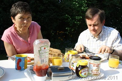 BREAKFAST ON THE LAWN_Mum and Dad enjoying breakfast on the lawn.
