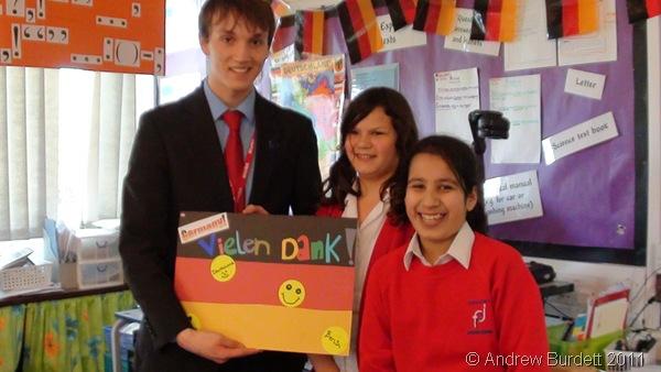 VIELEN DANK_Pupils give Ben Scrace a 'thank you' card after teaching them German.