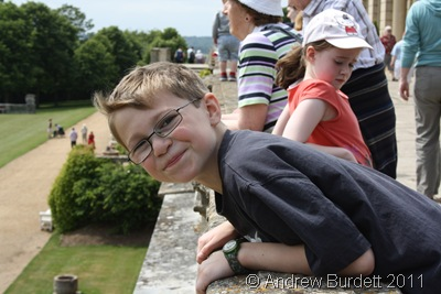 MY HOUSE AND HOME_Matthew, ten, on the balcony at Cliveden house.